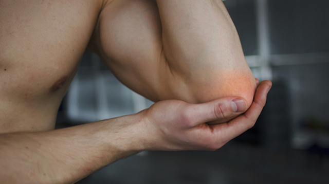 Боль в локте после тренировок: причины, способы лечения